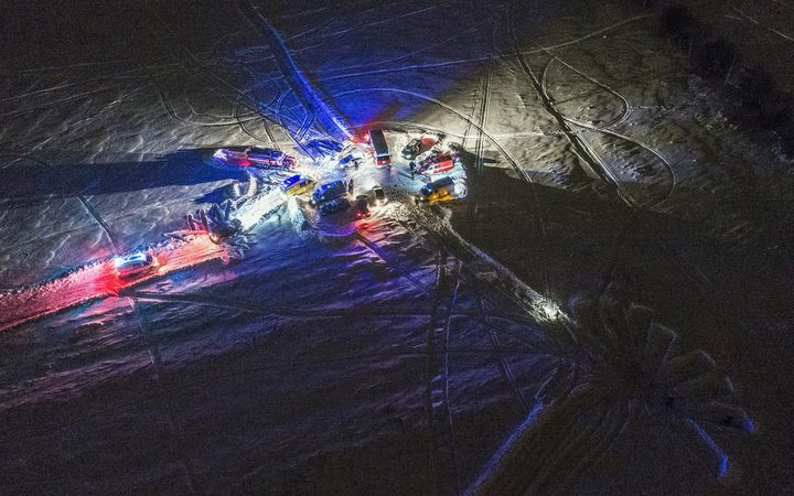 An aerial view of emergency vehicles arriving near the site of the air crash in Ramensky district near Moscow.
