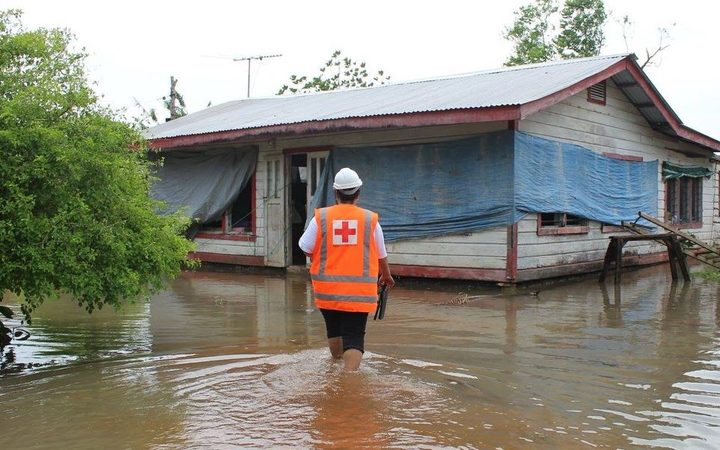 Red Cross staff checking on people flooded out in Samoa.