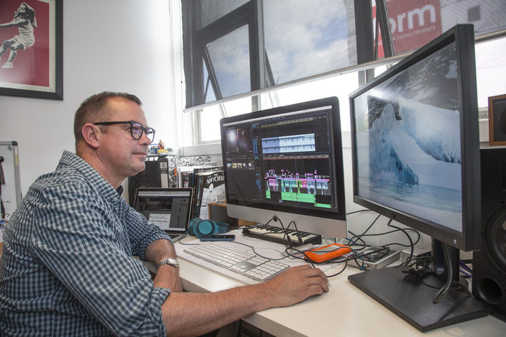Damian Christie editing footage he shot in Antarctica.