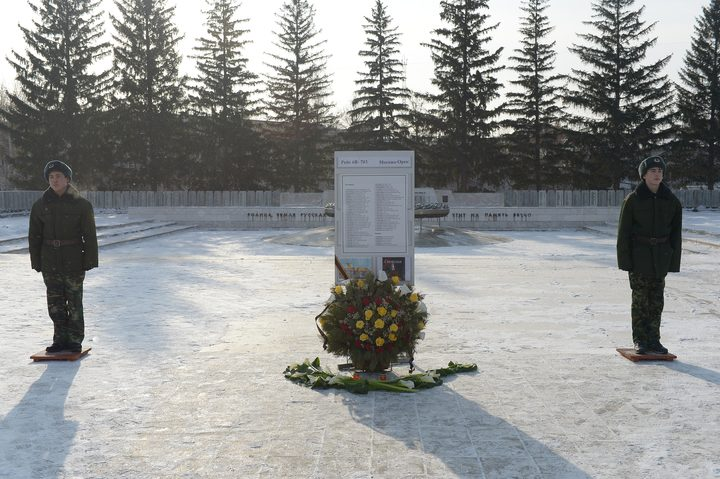 Flowers are placed at an eternal flame and list of the dead in memorial after the Saratov Airlines crash.