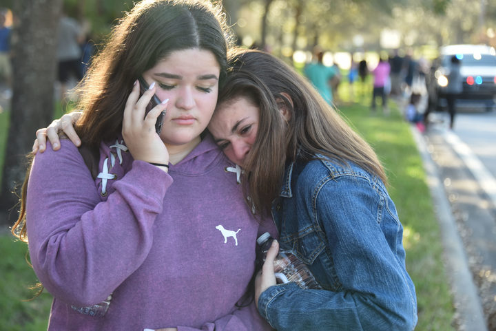 Students react following the shooting at Marjory Stoneman Douglas High School in Parkland, Florida.