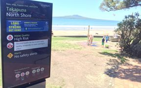 A warning sign at Takapuna beach.