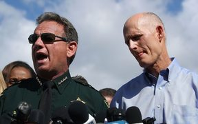 Broward County Sheriff, Scott Israel (C), Florida Governor Rick Scott.