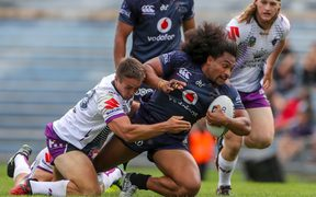 Warriors prop Bunty Afoa with possession against Melbourne Storm in Rotorua