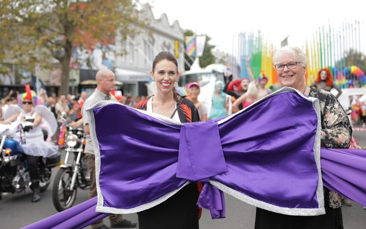 Prime Minister Jacinda Ardern and Lexie Matheson of the Auckland Pride Festival board.