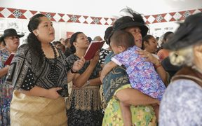 People attend church in NUku'alofa, the first Sunday after Cyclone Gita struck