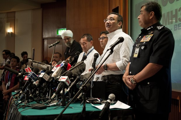 Malaysia's acting Transport Minister Hishammuddin Hussein (second from right) at Sunday's news conference.