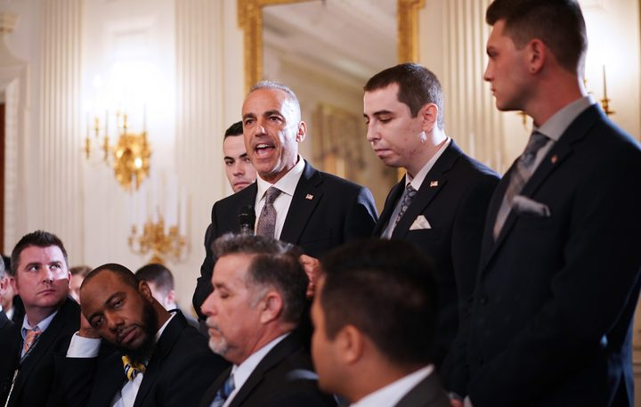 "Andrew Pollack, flanked by his sons, speaks during Donald Trump's ""listening session"" on gun violence"