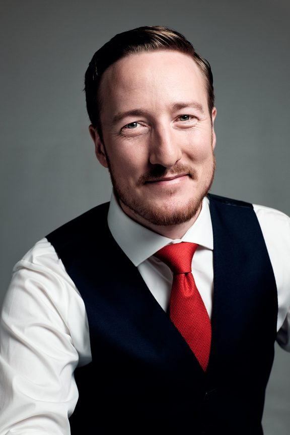 New Zealand baritone Christopher Bruerton is part of the sextet The King's Singers.
