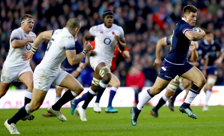 Scotland's Huw Jones breaks free against England.