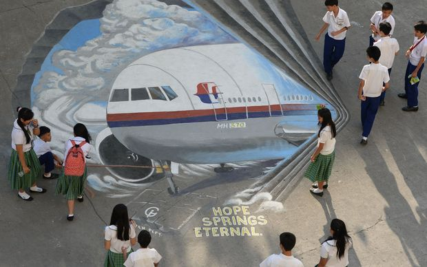 A giant mural of the missing Malaysian plane at a Manila schoolground.