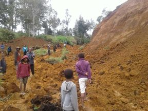 A landslide cutting of the road from Tambul to Mendi following a 7.5 earthquake.