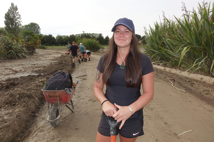 Student Kristiane Ellery volunteered to help dig homes out of the mud. She says it's a tough job, and not just physically.