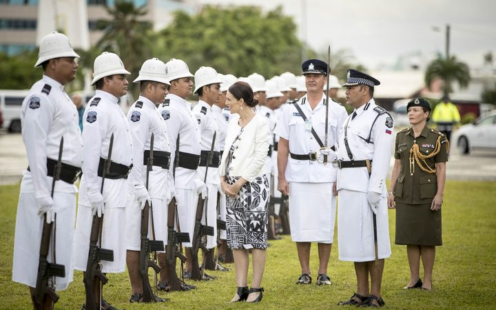 Jacinda Ardern inspects the Guard of Honour in Samoa.