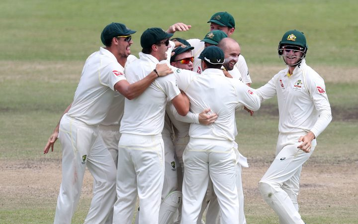 Nathan Michael Lyon of Australia celebrates with teammates after dismissing AB de Villiers of South Africa