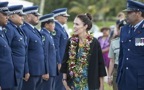 Jacinda Ardern inspects a police Guard of Honour during her visit to Niue.