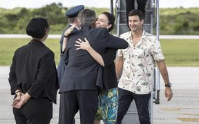 Prime Minister Jacinda Ardern is greeted by her father Ross Ardern, the High Commissioner.