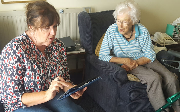 volunteer Robyn Grant helping Kerikeri Retirement Village resident Judith Donald (right) to get to grips with the online census process.