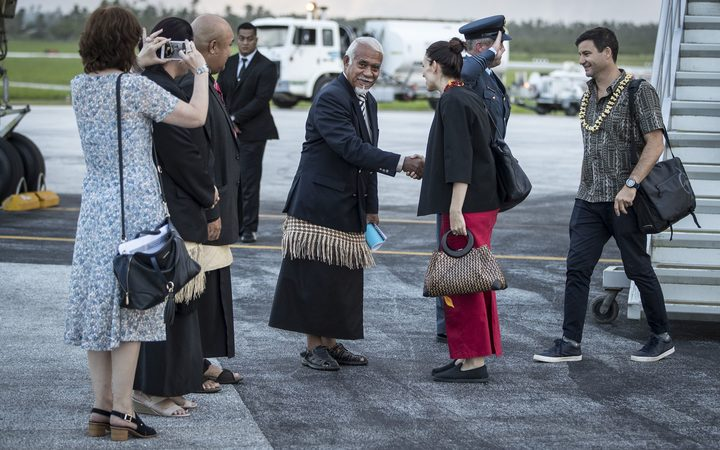 Jacinda Ardern and her partner, Clarke Gayford, are welcomed after landing in Tonga.