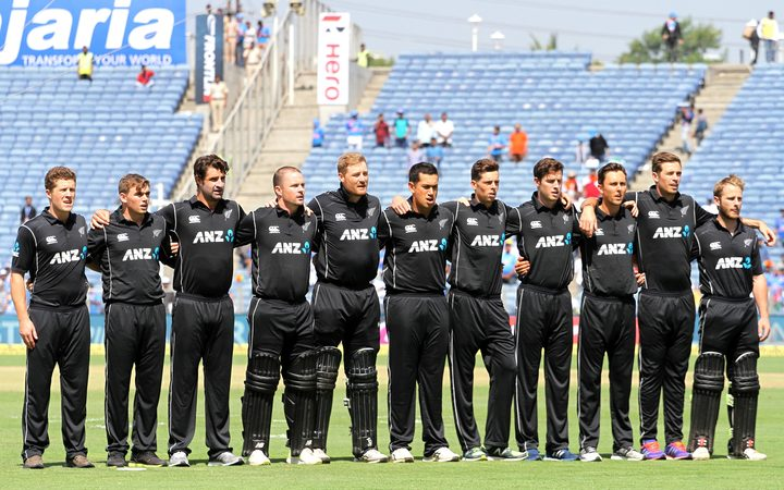 New Zealand Black Caps stand for the national anthem before the start of the match, India v New Zealand Black Caps. Second ODI, one day international cricket match in Pune, 2017.
