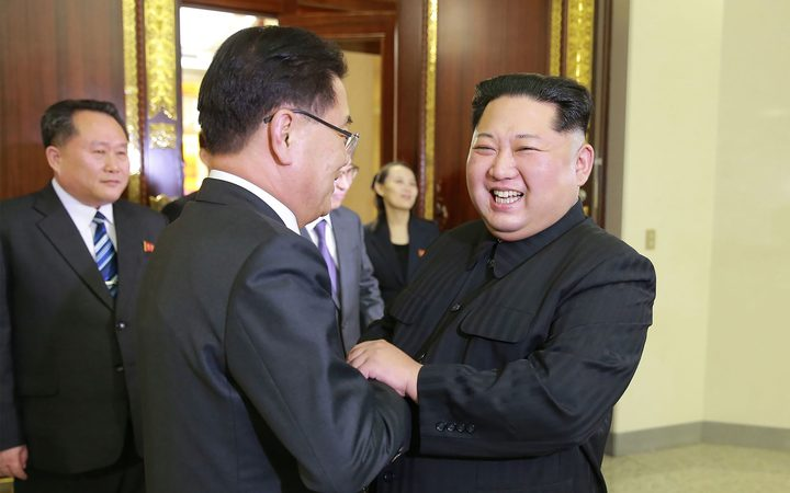 North Korean leader Kim Jong-Un (R) shakes hands with South Korean chief delegator Chung Eui-yong.