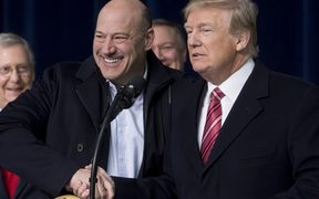 US President Donald Trump shakes hands with Gary Cohn, Director of the National Economic Council.