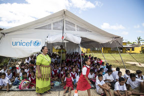 Tents are being used as temporary classrooms after the destruction of Cyclone Gita.