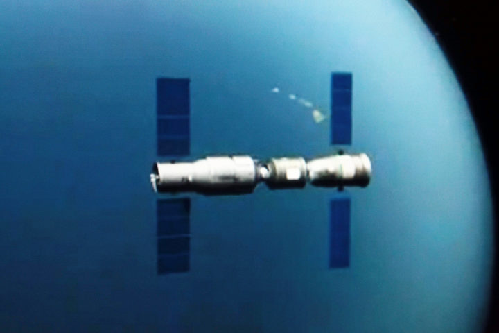 This TV grab taken on 2 November 2011 shows an animated video clip of the docking of the Tiangong-1 space lab module and the Shenzhou VIII (Shenzhou-8) spacecraft in space.