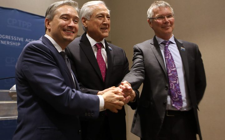 New Zealand's Trade and Export Growth Minister David Parker (R), Chile's Foreign Minister Heraldo Munoz (C),  and Canada's Trade Minister Francois-Philippe Champagne pose before signing the CPTPP in Santiago.