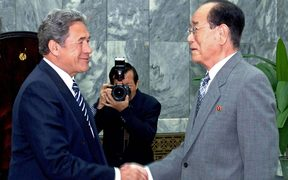 Winston Peters (left) shakes hands with  a representative of the North korean government at a meeting in Pyongyang in 2007.