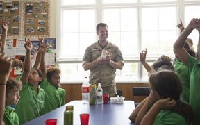 New Zealand Army dentist Lieutenant Tim Reiber asks the students a question during a class on Healthy lifestyles.