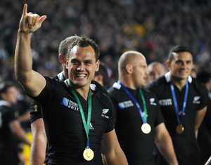 Israel Dagg, left, after the All Blacks beat France to win the World Cup.