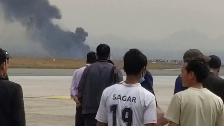 This screengrab of video footage from the Facebook account of Nitin Keyal shows smoke rising from the site of the crash