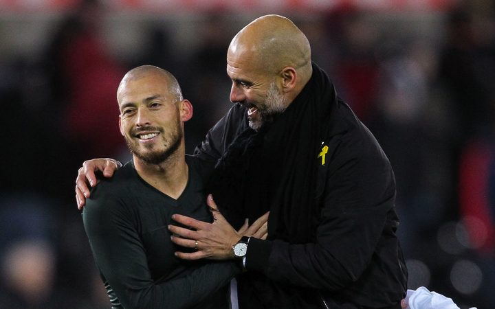 David Silva of Manchester City and Pep Guardiola manager of Manchester City.