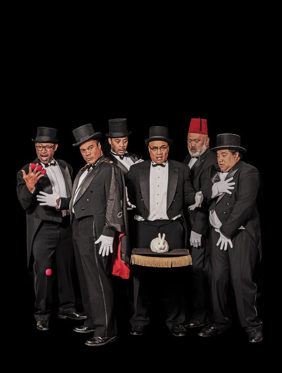Poster image for the show 'The Naked Samoans Do Magi' showing the cast dressed in tuxedos, gathered around a white rabbit.