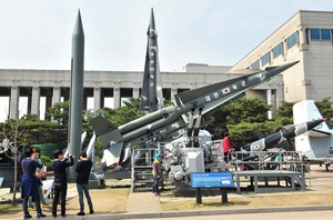 Visitors look at replicas of North Korean missiles at the Korean War Memorial in Seoul after North Korea test-fired two medium-range ballistic missiles.