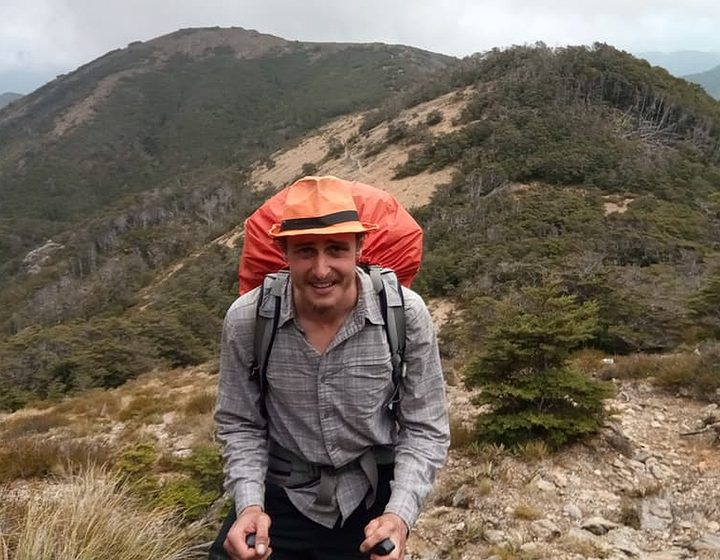 An image of Bruce's hiking buddy Bevan, high on a hill in the Richmond Ranges..