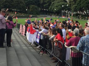 A sing-off on the steps of the New Zealand parliament between protestors and Indonesians during president Joko Widodo's visit to Wellington. 19 March 2018