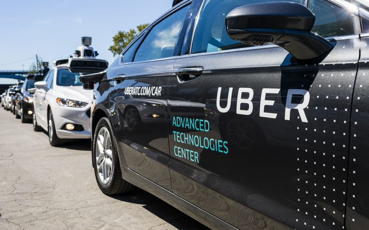 In this file photo taken on September 13, 2016, pilot models of the Uber self-driving car are displayed at the Uber Advanced Technologies Center in Pittsburgh, Pennsylvania.