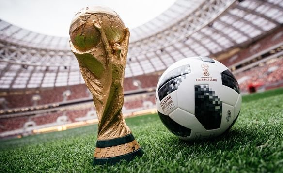 The World Cup trophy and the official ball for the 2018 World Cup in Moscow.