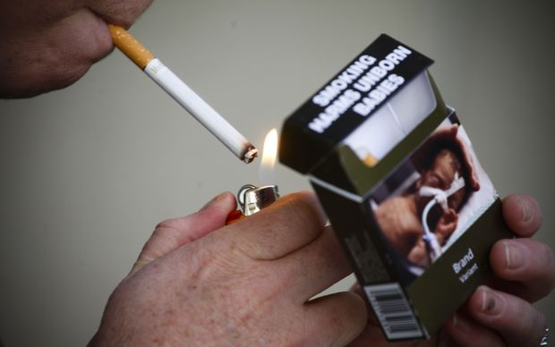 A cigarette pack with plain packaging.