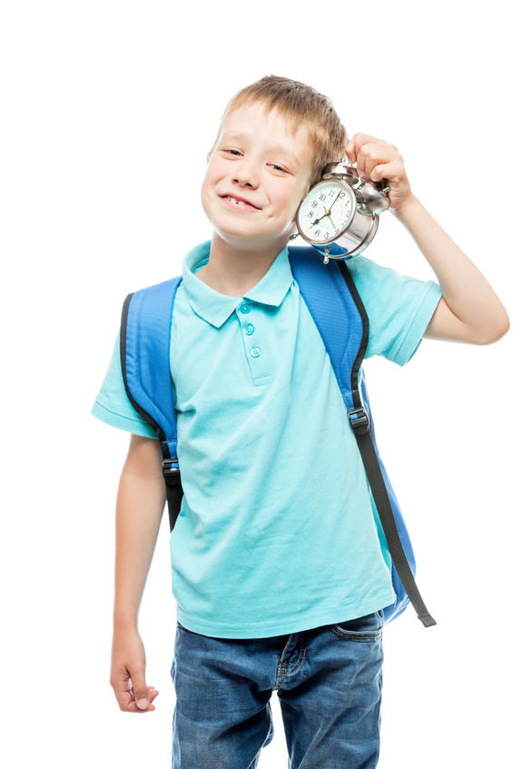 A photo of a schoolboy with an alarm clock