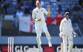 Trent Boult celebrates the wicket of England captain Joe Root.