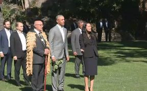 Barack Obama is welcomed to Government House.
