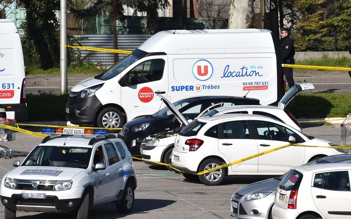 A vehicle is cordoned off, believed to belong to the hostage taker, and parked outside the Super U supermarket in the town of Trebes, southern France on March 23, 2018.