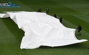 The covers over the wicket as the rain arrives.