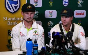Australia's captain Steve Smith (R), flanked by teammate Cameron Bancroft, speaking as he admitted to ball-tampering during the third Test against South Africa.