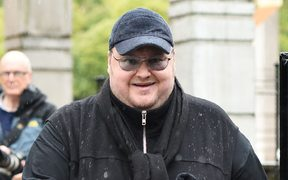 Internet mogul Kim Dotcom leaves following his extradition appeal at the High Court in Auckland on August 29, 2016.