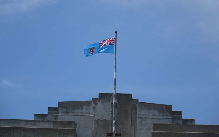 The flag of Fiji flies atop the parliament buildings in Suva.