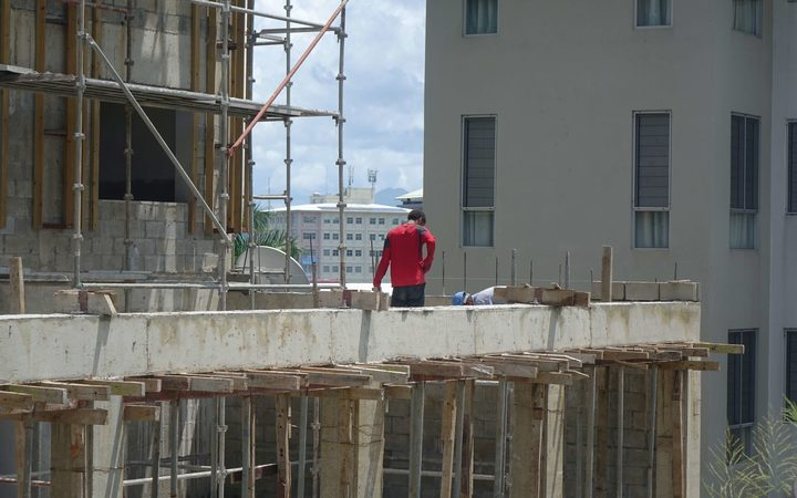 Workers on a construction site in Fiji's capital, Suva.
